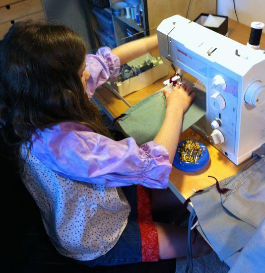 Caitlyn sews.