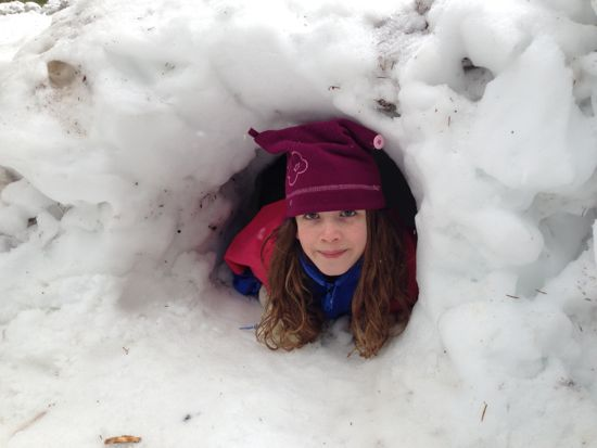 Caitlyn in a snow tunnel